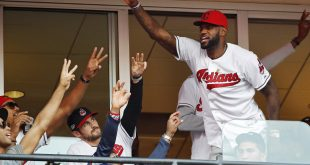 Clevelanders, including LeBron James of the NBA Cavaliers, are psyched about the Indians' postseason success. James is seen at Game 2 of baseball's AL Championship Series between the Indians and the Toronto Blue Jays in Cleveland on Oct. 15.