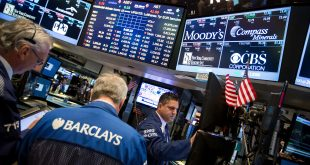 Traders work on the floor of the New York Stock Exchange on Monday. Rising stock prices typically help an incumbent party in a presidential election year, but October can be a wild month.
