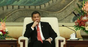 Philippine President Rodrigo Duterte, seen here during a meeting at the Great Hall of the People in Beijing, says he's separating from the U.S. and seeking closer ties with China.