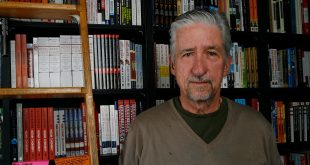 Author Tom Hayden poses before signing copies of his book, Ending The War in Iraq at Book Soup in Los Angeles in 2007. Hayden has died at 76.