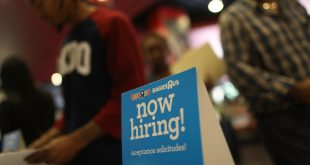 "A ""now hiring"" sign is seen at the Toys R Us booth during the JobNewsUSA job fair at the BB&T Center on Nov. 15 in Sunrise, Fla."