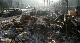 The remains of a business in Gatlinburg, Tenn., smolder on Nov. 29, after a devastating wildfire damaged or destroyed more than 2,000 buildings and killed at least 14 people.