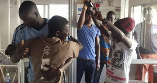 Gambians cheers in the city of Bakau on Thursday after watching a broadcast of Adama Barrow being sworn in as Gambian president at the Gambian Embassy in Dakar, Senegal.