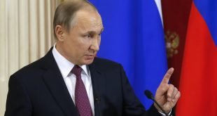 "Russian President Vladimir Putin, shown during a joint news conference with his Moldovan counterpart following their meeting Tuesday in Moscow, said President-elect Donald Trump won a ""convincing victory."""