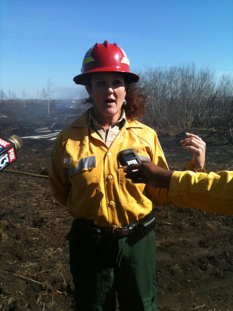 Florida Fire Service's Wildfire Mitigation Specialist Ludie Bond talking to reporters on Monday (photo by Jillian Baach)