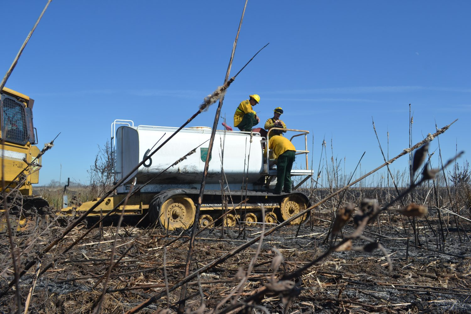 Forestry officials transport water to the fire scene (photo by Chris Gilmore)