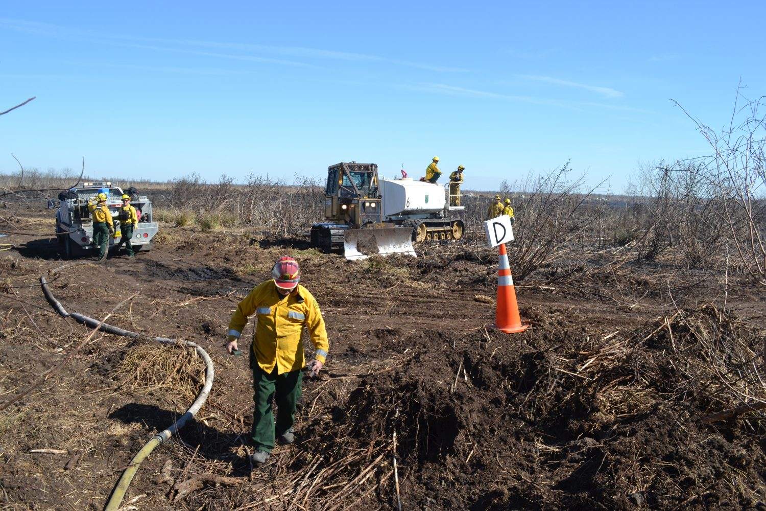 Forestry officials at the fire scene on Paynes Prairie on Monday (photo by Chris Gilmore)