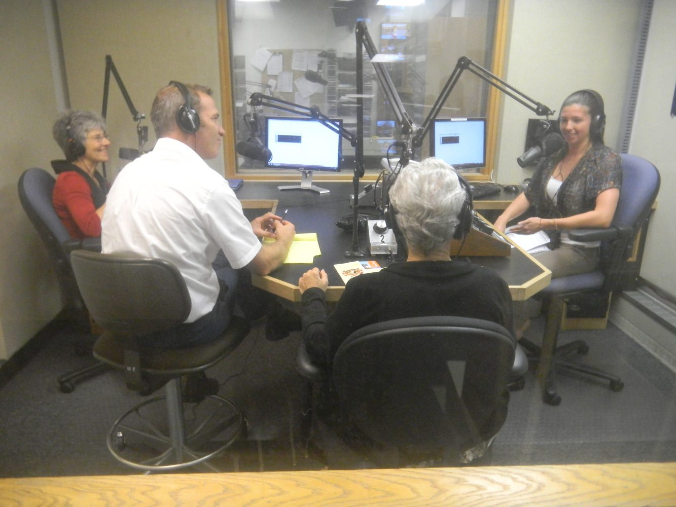 Executive Staff of the River Phoenix Center for Peacebuilding being interviewed by WUFT-FM's Kelsey Diaz (photo by Donna Green-Townsend)