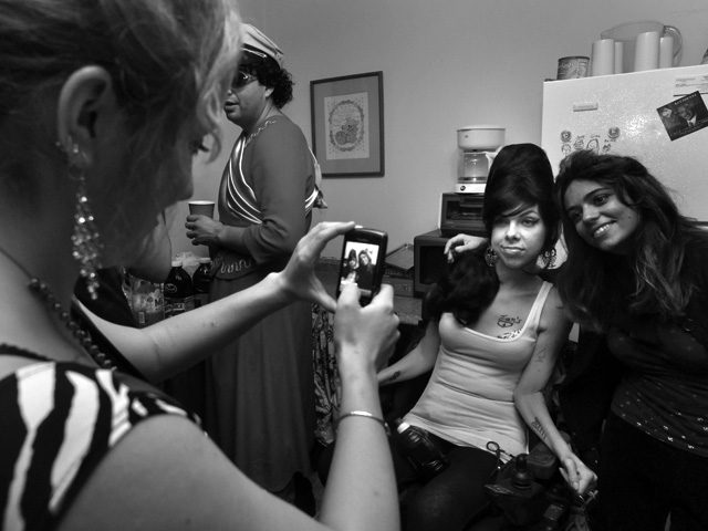 """Meaghan gets photographed with friends at her 6th annual """"Spinal Cord Injury Celebration"""" party in October 2011."""