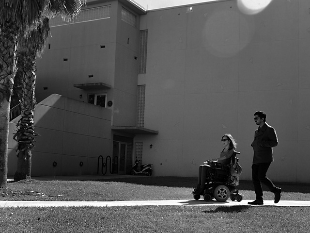 Accompanied by a friend, Meaghan Gallagher changes classes at Santa Fe College.