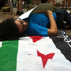 UF Syrian students portray death during a freeze mob to demonstrate the price of fighting for freedom in Syria.