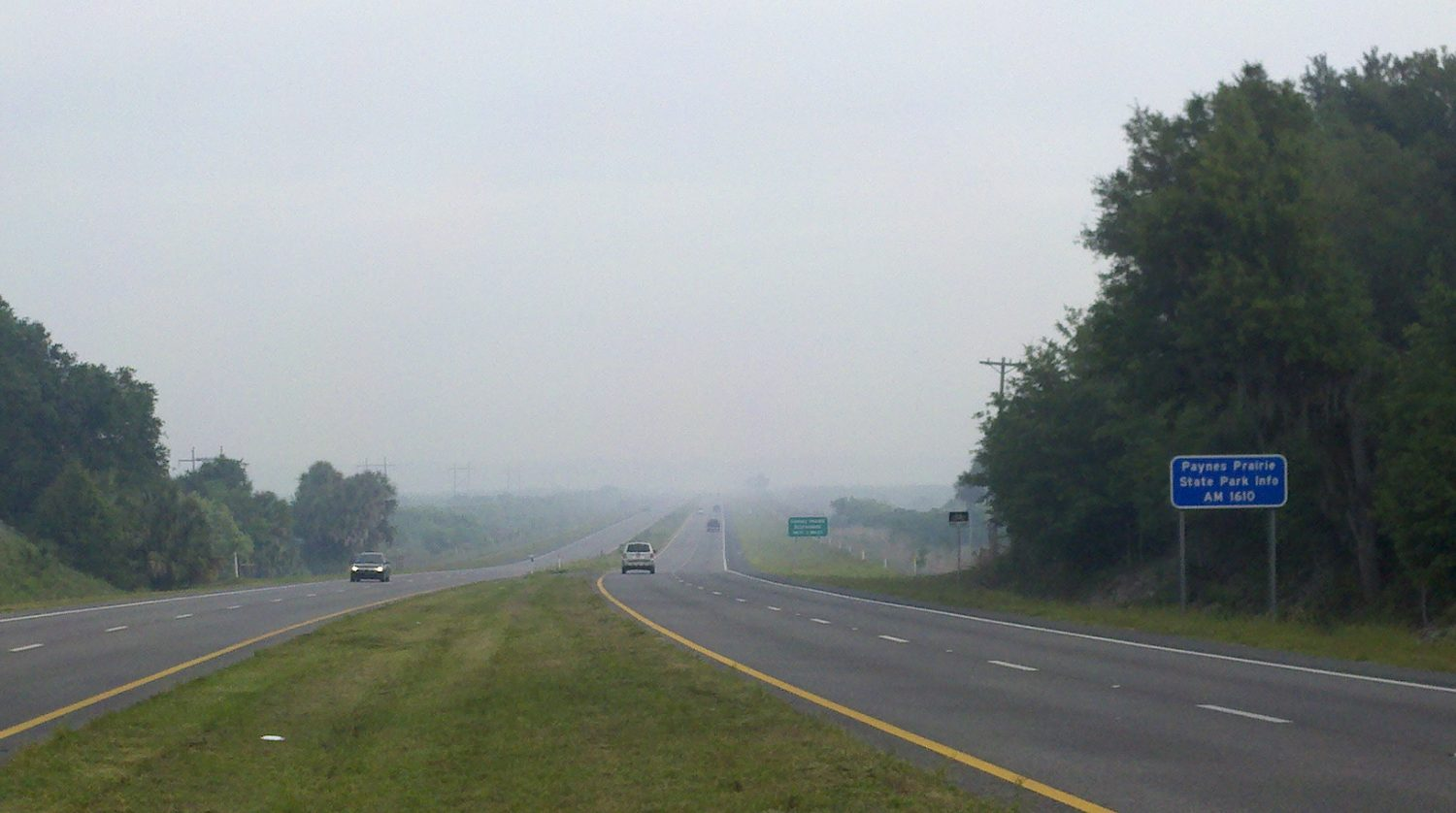 Smoke from recent wildfires is evident on U.S. Highway 441 across Payne's Prairie.
