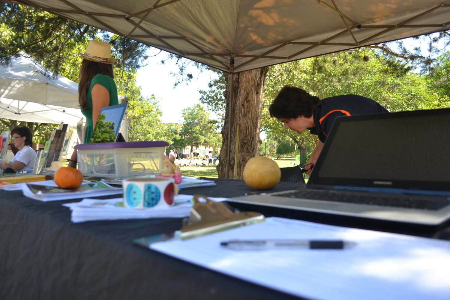 Representatives from Alachua County Sustainability Programs Grant McCleod and Corinne Gentile promote the Farmer's market and local farmers at Campus Earth Day.