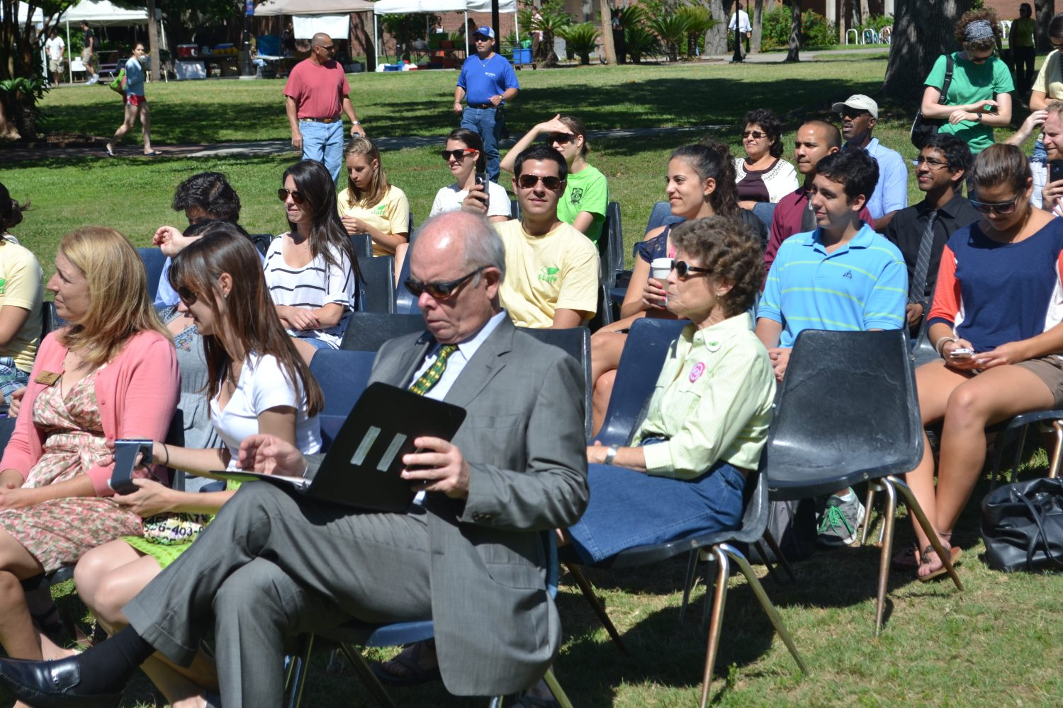 UF president, Bernie Machen, listens to the program at Campus Earth Day