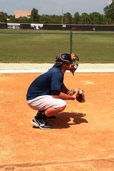 Catcher takes position during a bullpen session