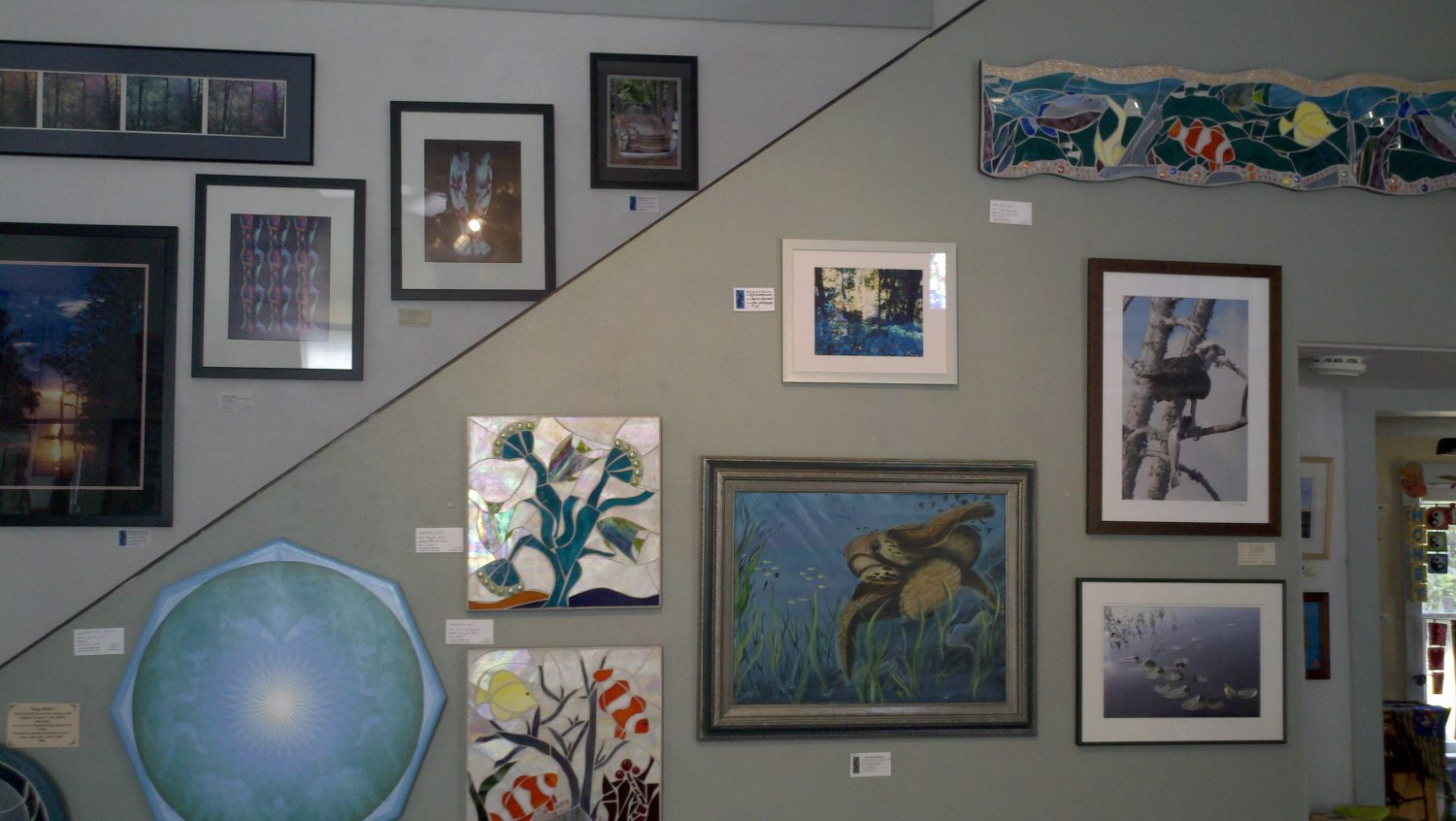 Artwork is displayed on the walls of the Shake Rag Art & Culture Center.