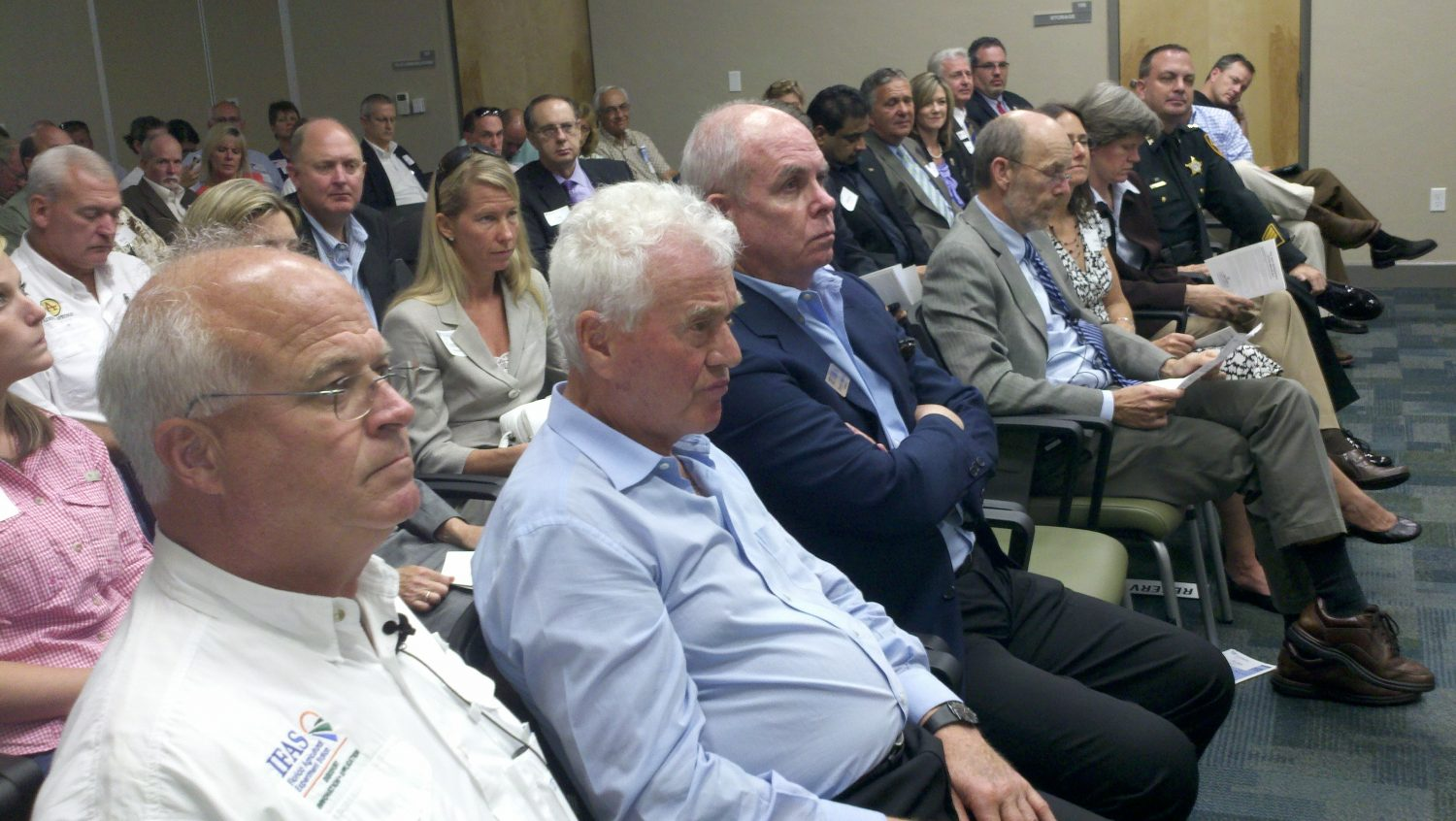 Director of Research Programs for the Frank Stronach Plant Science Center Danny Colvin sitting next to Frank Stronach and UF President Bernie Machen at Tueday's dedication ceremony.