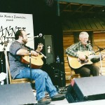 Doc Watson performing at the Suwannee Springfest  near Live Oak, Florida with his grandson in 2000.