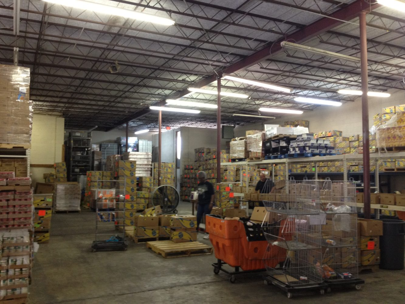 The warehouse holds a number of pallets where donations are temporarily kept
