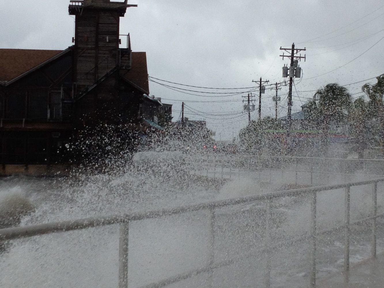 Strong waves pound Cedar Key's city wall.