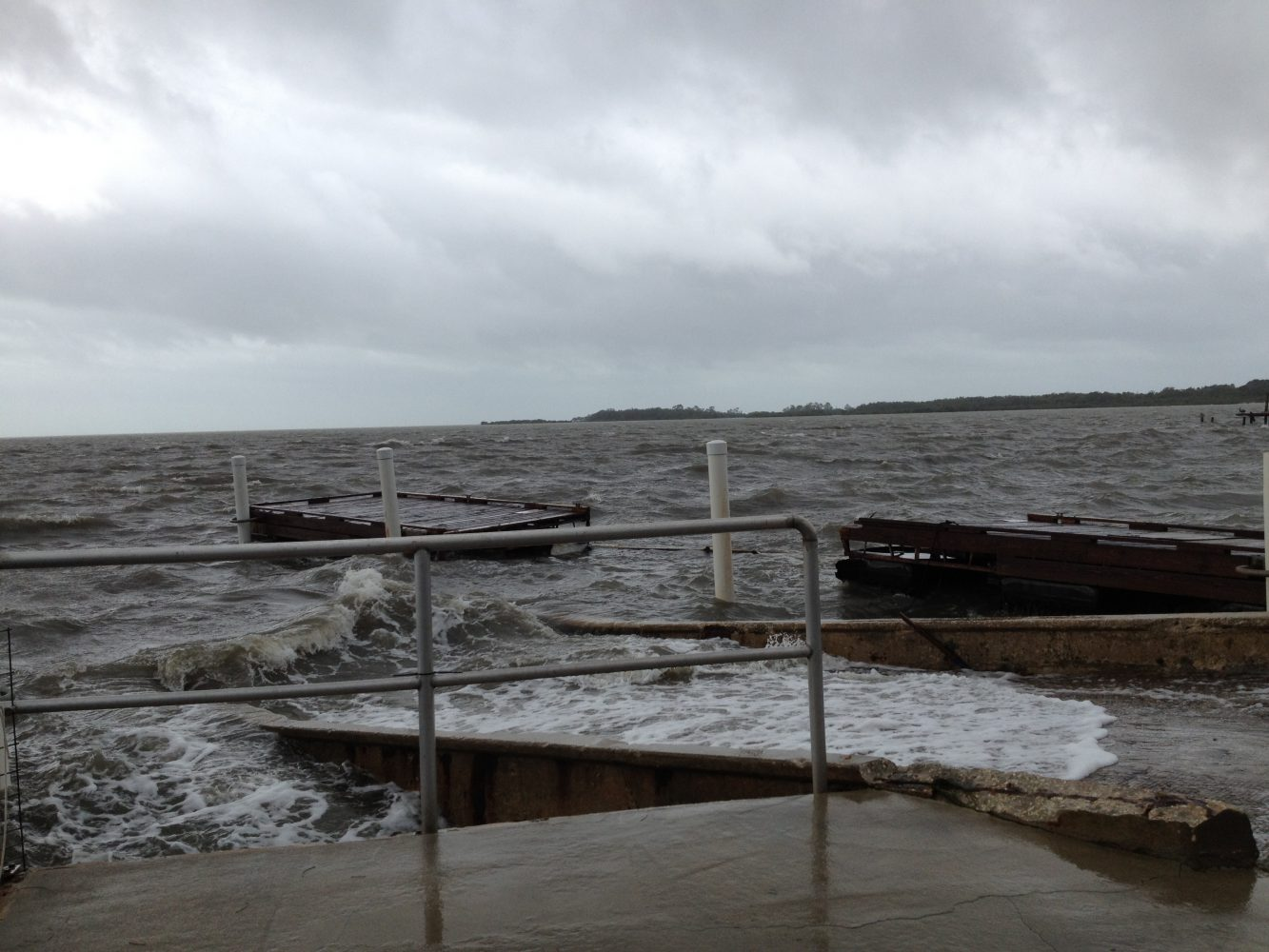 Floating docks being swept away by strong waves from Tropical Storm Debby
