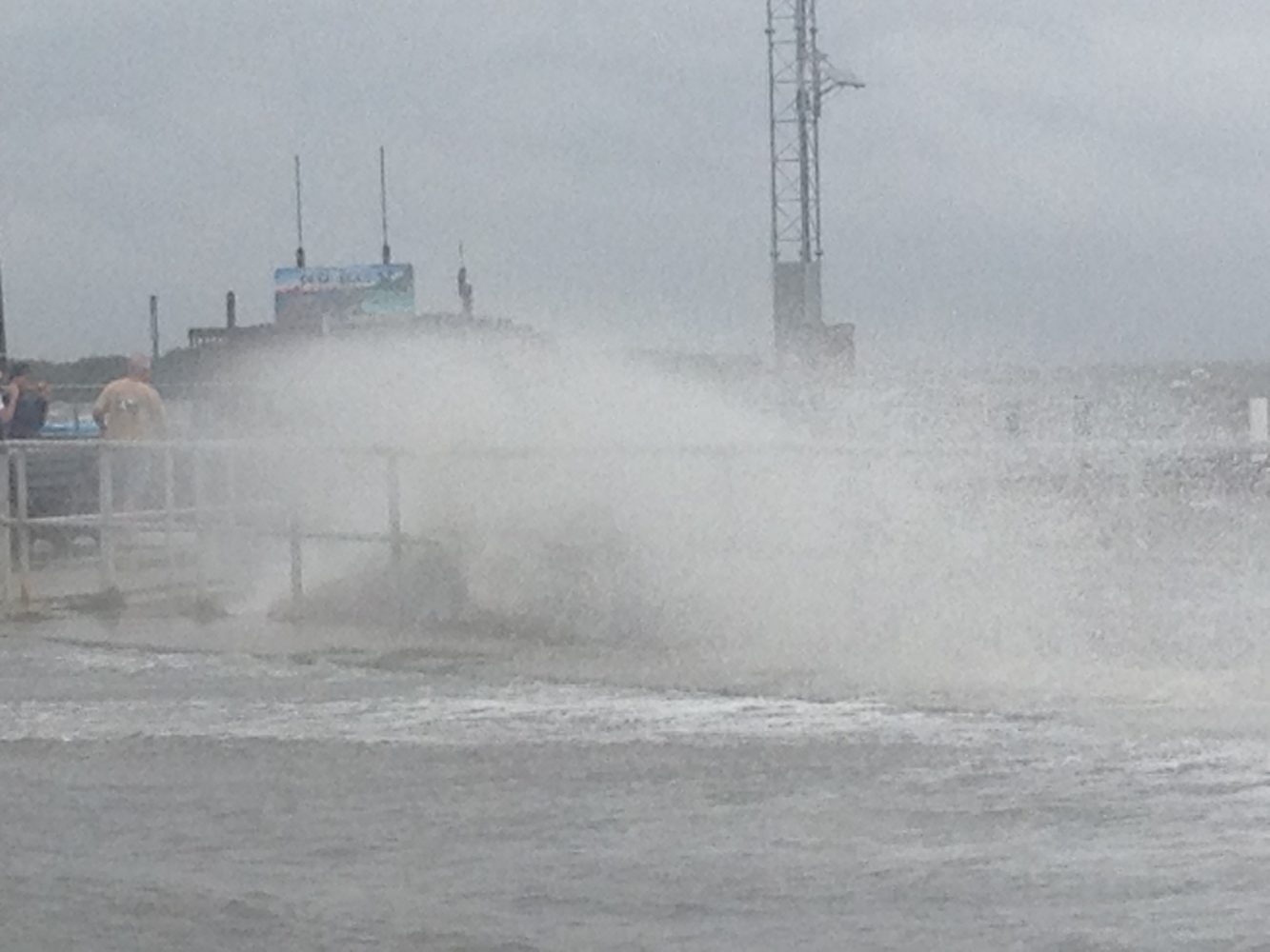 Waves washed ashore Cedar Key in Levy County Sunday afternoon