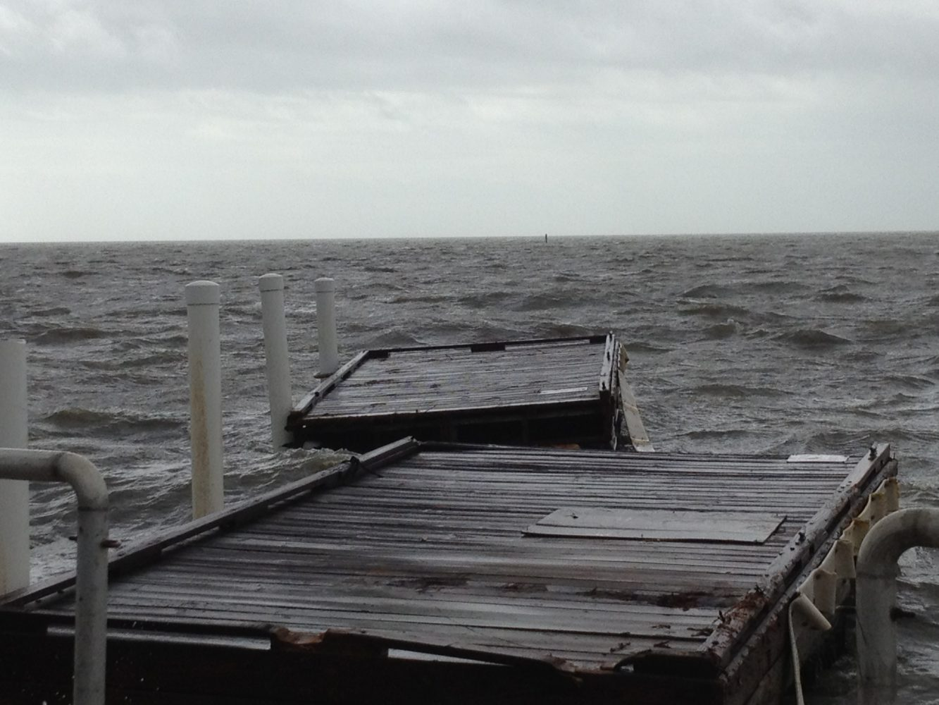 Floating docks torn away by strong waves and wind from Tropical Storm Debby