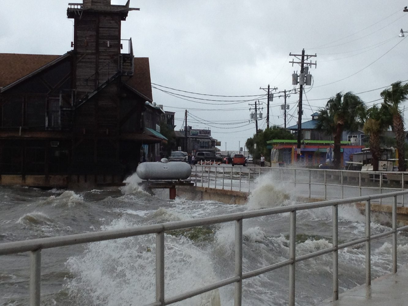 Strong waves lapping at Cedar Key's City wall from Tropical Storm Debby