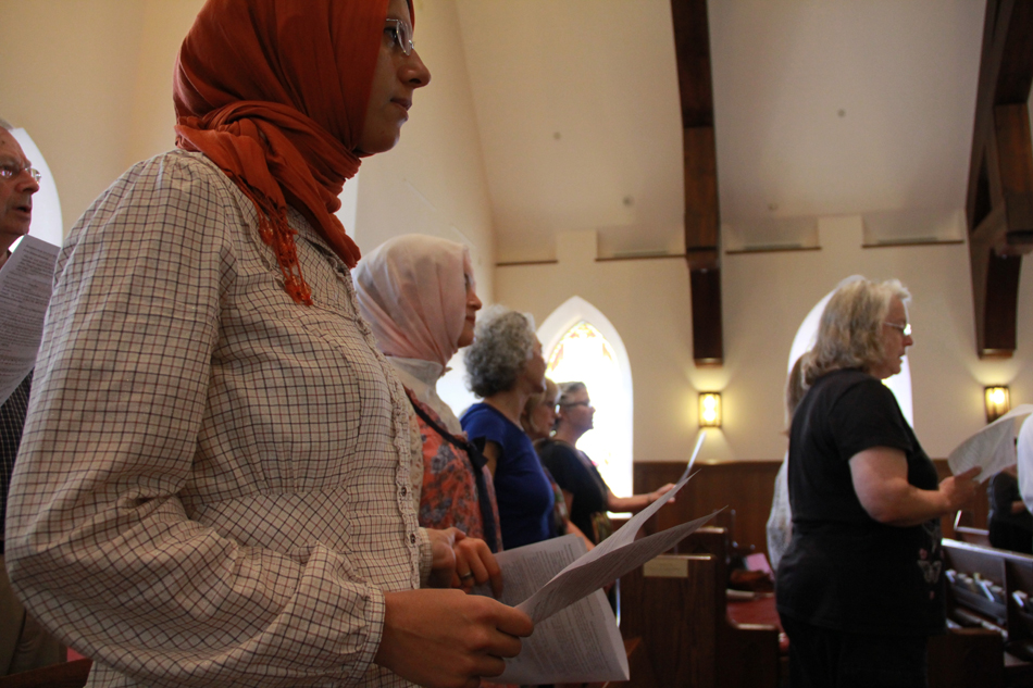 University of Florida student Aysegul Ozkam participates in a Sept. 11, 2012, service at the Holy Trinity Episcopal Church in Gainesville.