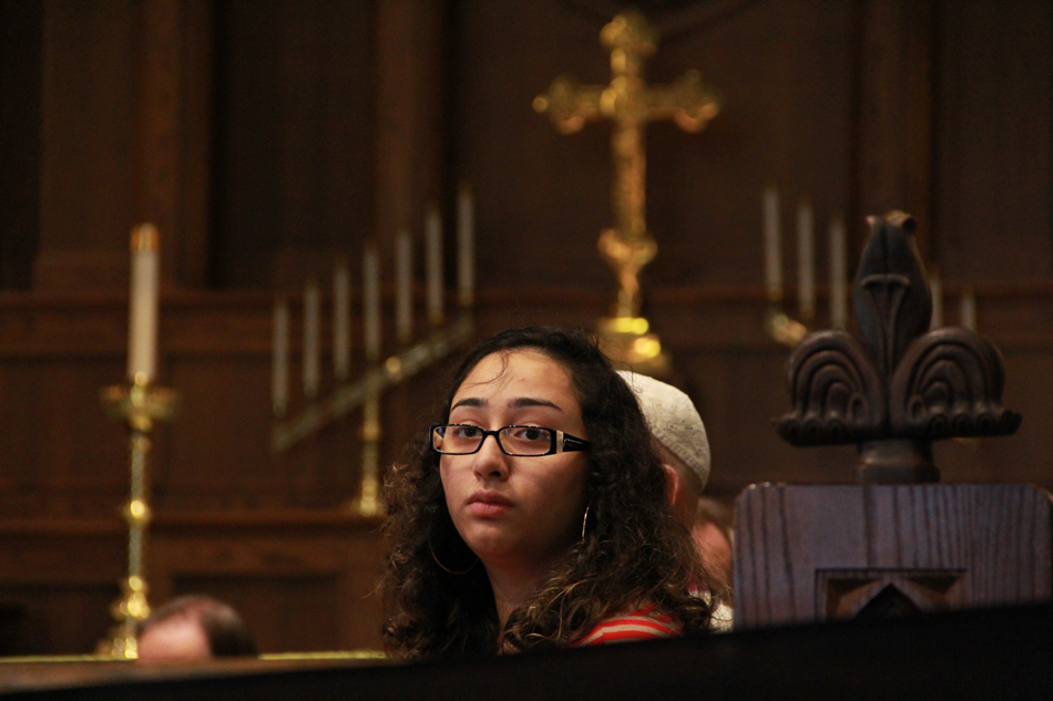 Rubin Kaur of the UF Sikh Student Association watches  the Sept. 11, 2012, service at the Holy Trinity Episcopal Church in Gainesville.