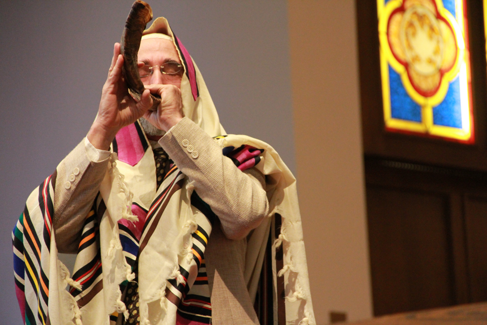 Rabbi David Shuman blows a horn during the Sept. 11, 2012, service at the Holy Trinity Episcopal Church in Gainesville.