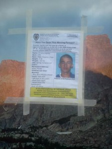 """Missing Person"" posters of Aguilar were posted on vehicles parked at the search check-in location. Photo by Kristen Botica."