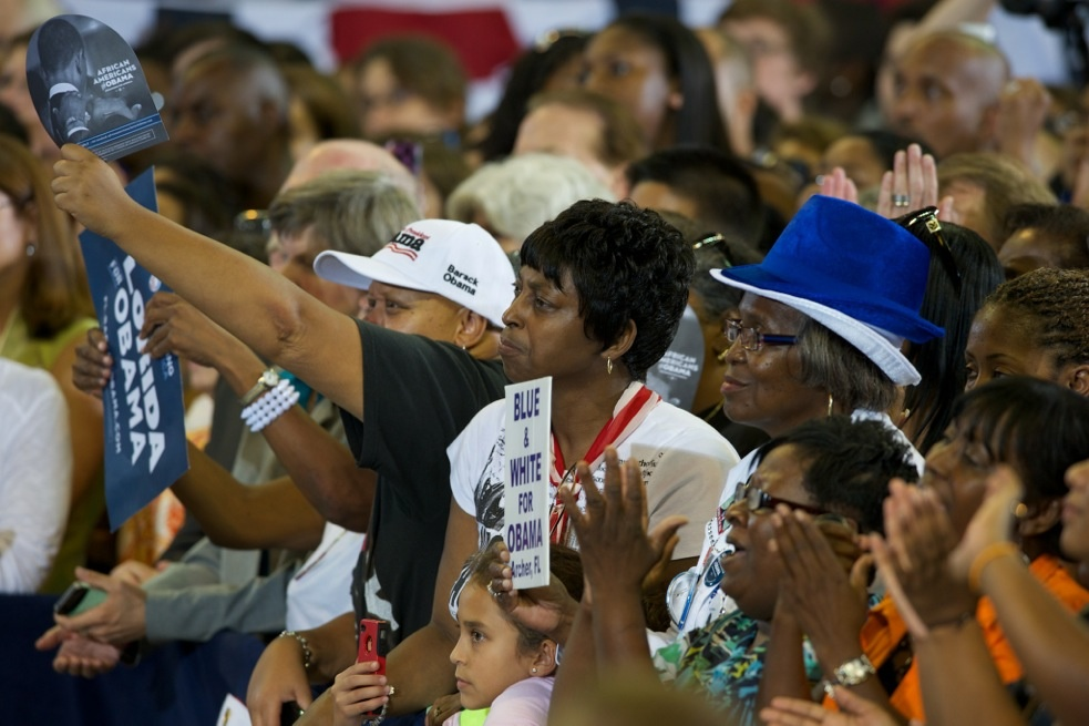 Attendees cheer as the first lady takes the stage inside the O'Connell Center Monday at the University of Florida.