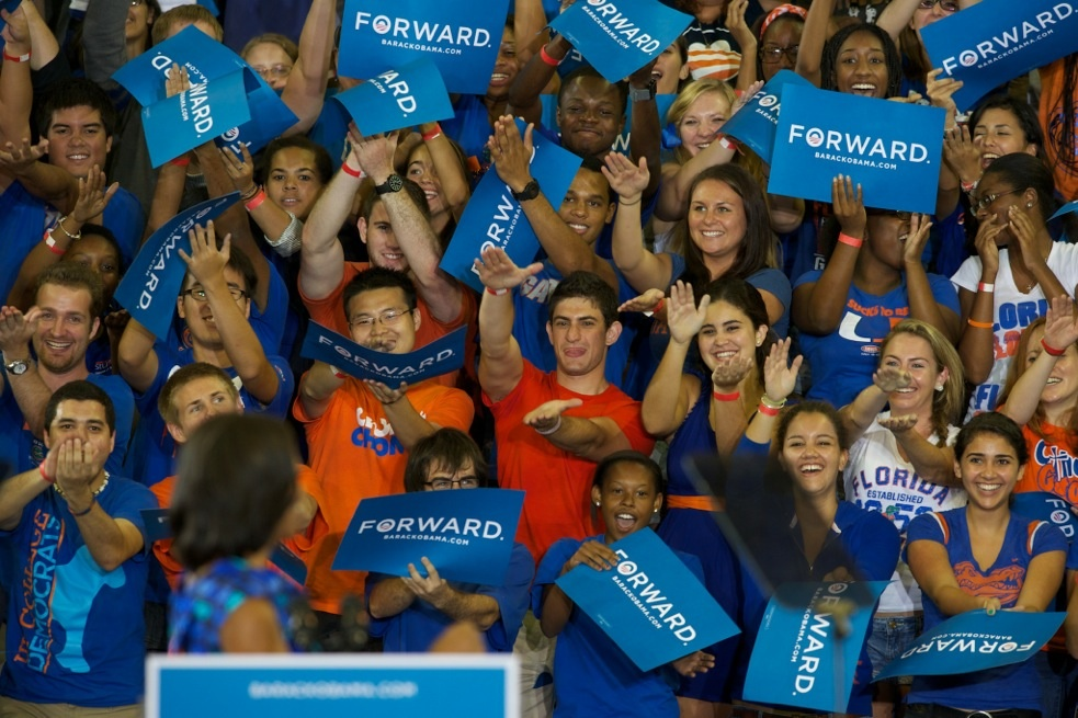 University of Florida students cheer for Michelle Obama during her speech Monday at the O'Connell Center.
