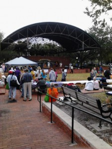 Attendees listen to a free concert at the Breakfast on the Plaza and Homeless Services Fair at Bo Diddley Plaza Thursday.
