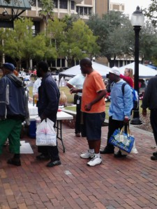 Homeless wait in line for a hot meal at the Breakfast on the Plaza and Homeless Services Fair at Bo Diddley Plaza Thursday.