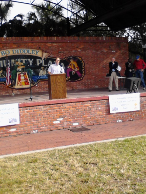 Alachua County Commissioner Lee Pinkoson speaks at the Breakfast on the Plaza and Homeless Services Fair at Bo Diddley Plaza Thursday.