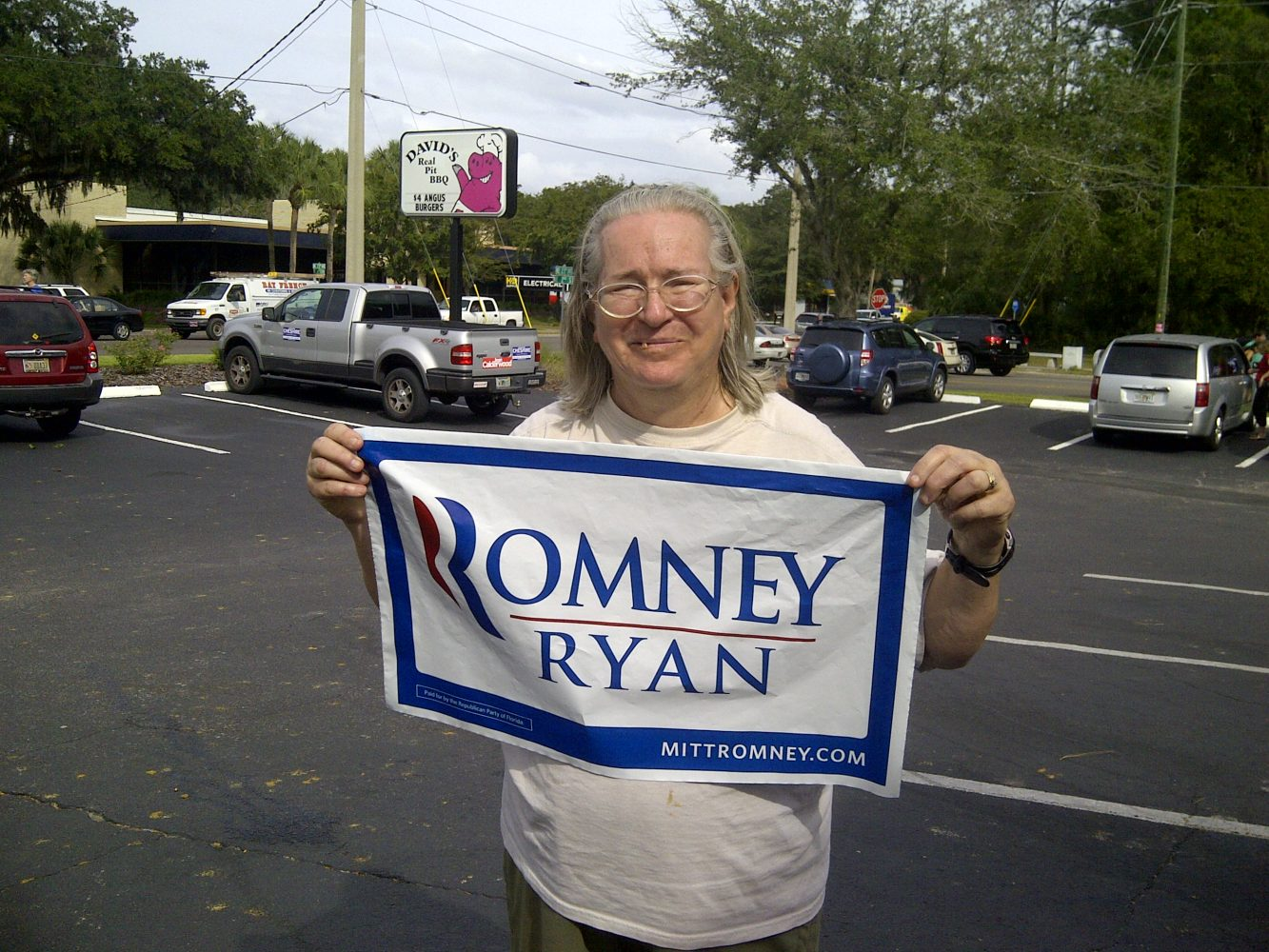 """Linda Holloway holds a Romney-Ryan campaign sign after Ann Romney's visit. """"I got to (shake) her hand,"""" Holloway said. """"I said we love you and God bless you."""" Holloway said she came out because she doesn't think Obama should be re-elected. """"I'm 200 percent for Romney,"""" she said."""