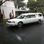 The hearse carrying Capt. Turnace H. Brown's remains arrives at Milam Funeral & Cremation Services in Gainesville.