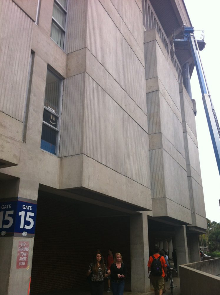 A cherry picker crew works to repair a portion of Ben Hill Griffin Stadium on Wednesday outside Gate 15.