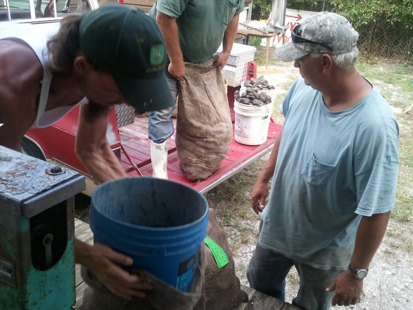 Oystermen add more oysters to make their 60-pound bushel weight requirement.