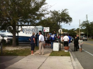 A crowd gathers to watch Ann Romney's campaign bus as it leaves David's Real Pit BBQ.