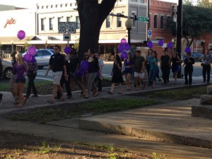 Attendees of Peaceful Paths' vigil Thursday marched in downtown Gainesville in observance of Domestic Violence Awareness Month.