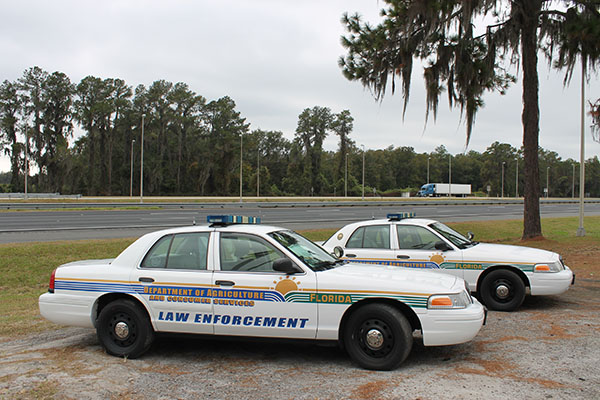 Ready for a chase at any time, agricultural law enforcement park vehicles at the Northbound Agricultural Inspection Station. There are 19 stations located across northern Florida. The stations are open 365 days a year, 24 hours a day. The officers work two shifts, one from 7 a.m. to 7 p.m. and vice versa. Every 28 days, the officers switch shifts.