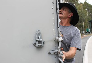 A driver opens his trailer to show agricultural law enforcement officers his cargo. Commercial vehicles transporting cargo including, food, building materials and animals must go through the inspection station. Animals ranging from kangaroos to sharks to horses pass through.