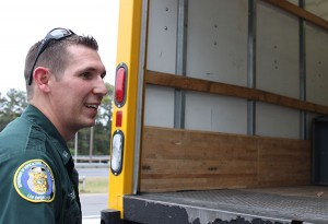 Officer Jason Ross talks with a commercial truck driver during an inspection. When inspecting a vehicle that is transporting food, officers look for food temperature, labeling and cross-contamination as well as general food safety. Ambient temperature and internal temperature are measured to make sure the food is not spoiled. Cross-contamination violations include putting boxes of meat on top of other food items such as produce. If a vehicle's cargo doesn't pass the inspection, the cargo may be destroyed or the vehicle and its cargo may be turned around.