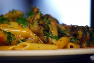 A dish with penne pasta and mushrooms waits on the counter for delivery. Fass prides the restaurant on making dishes to order, allowing more choices for vegans, vegetarians and others with alternative diets.