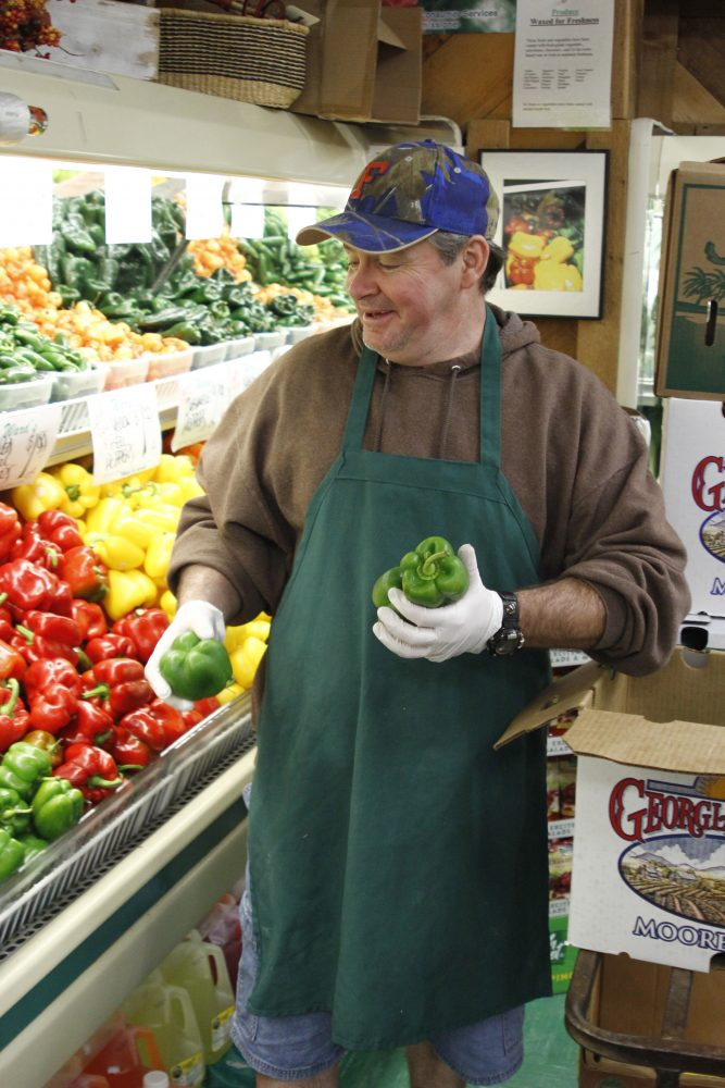 John Gillard, 52-year-old Ward's employee, fills a walk-up cooler with produce on Nov. 16.