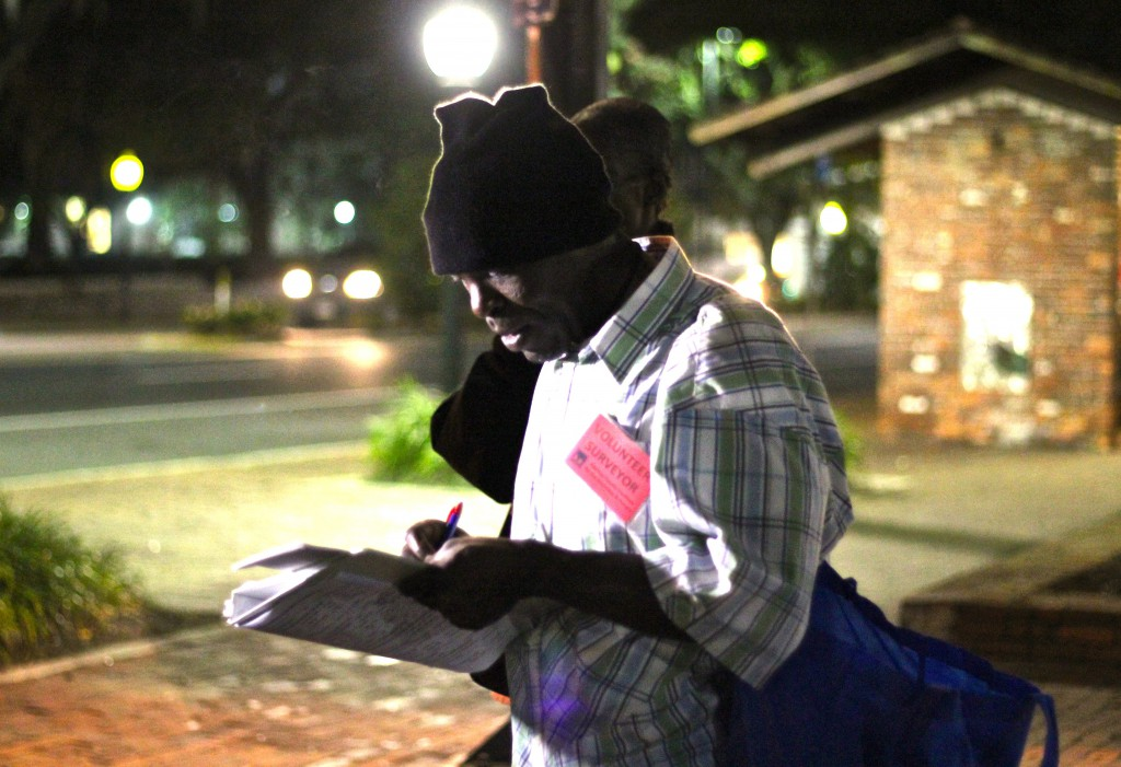 Don Small, one of the volunteers, administers a survey at about 5 a.m. Tuesday at Bo Diddley Plaza.