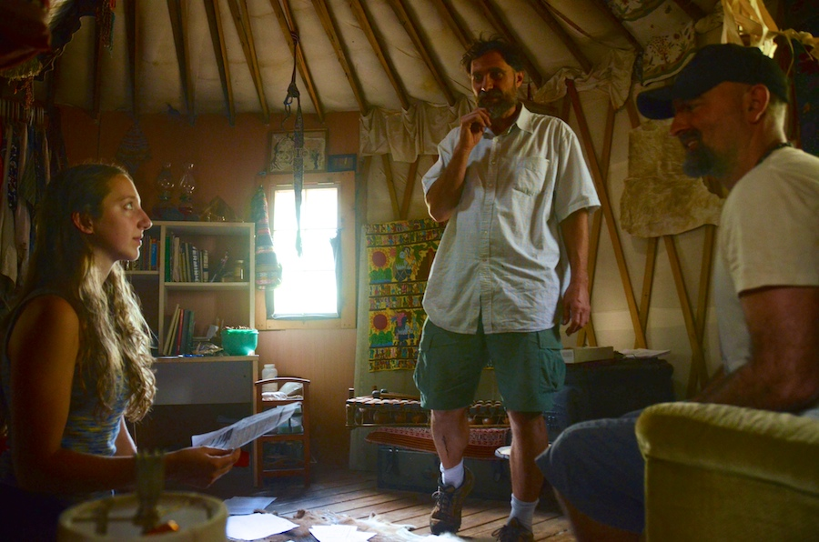 "Michael ""Mycol"" Stevens, 43, the owner of Finca Mycol and one of the organizers of the Florida Earthskills Gathering, talks with volunteers in his yome (a one-room yurt-style house) on Wednesday."